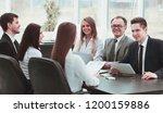 business team holds a workshop... | Shutterstock . vector #1200159886
