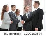 business meeting of partners in ... | Shutterstock . vector #1200163579