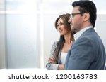 business partners standing... | Shutterstock . vector #1200163783
