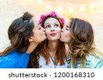 women kissing a happy girl on... | Shutterstock . vector #1200168310