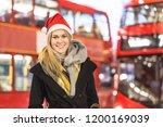 beautiful woman wearing santa... | Shutterstock . vector #1200169039