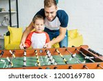 father and son playing table... | Shutterstock . vector #1200169780