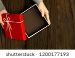 top view of female hands... | Shutterstock . vector #1200177193