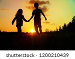 silhouette of happy boy and... | Shutterstock . vector #1200210439