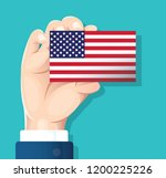 hand holding the usa flag card... | Shutterstock .eps vector #1200225226