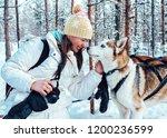 Girl And Husky Dog In Sled In...