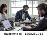 group of serious businesspeople ... | Shutterstock . vector #1200282013