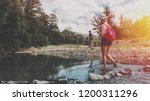young couple is walking along... | Shutterstock . vector #1200311296