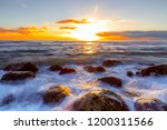 ocean sunrise and rocks from... | Shutterstock . vector #1200311566