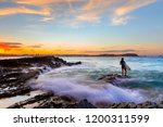 surfer standing on the end of a ... | Shutterstock . vector #1200311599