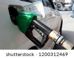 fuel pumps at a gas station in... | Shutterstock . vector #1200312469