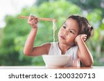 cute asian child girl bored to... | Shutterstock . vector #1200320713