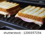 preparing tasty toast with ham... | Shutterstock . vector #1200357256