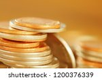 row of coins on wood background ... | Shutterstock . vector #1200376339