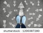 woman standing on asphalt road... | Shutterstock . vector #1200387280