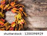 autumn wreath on wooden...   Shutterstock . vector #1200398929