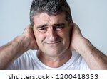 portrait of an attractive man... | Shutterstock . vector #1200418333