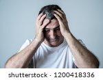 portrait of an attractive man... | Shutterstock . vector #1200418336
