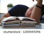 tired male student at workplace ...   Shutterstock . vector #1200445396