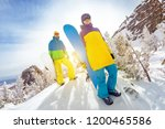two snowboarders male and... | Shutterstock . vector #1200465586