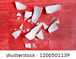 white shards of a broken plate...   Shutterstock . vector #1200501139