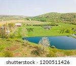 aerial of farmland and farm... | Shutterstock . vector #1200511426