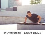 young and strong guy training... | Shutterstock . vector #1200518323