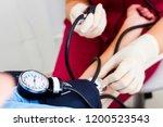 the doctor measures the... | Shutterstock . vector #1200523543