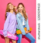two young stylish smiling blond ... | Shutterstock . vector #1200539410