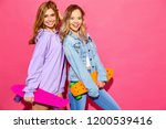 two young stylish smiling blond ... | Shutterstock . vector #1200539416