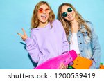 two young stylish smiling blond ... | Shutterstock . vector #1200539419