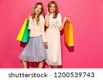portrait of two young stylish... | Shutterstock . vector #1200539743