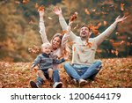 happy family playing with... | Shutterstock . vector #1200644179