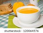 pumpkin soup in a white plate | Shutterstock . vector #120064576