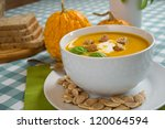 pumpkin soup in a white plate... | Shutterstock . vector #120064594