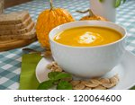 pumpkin soup in a white plate... | Shutterstock . vector #120064600