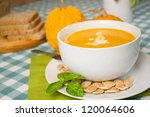 pumpkin soup in a white plate... | Shutterstock . vector #120064606