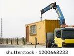 crane truck unloading portable... | Shutterstock . vector #1200668233