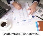 bisinessman working his job at... | Shutterstock . vector #1200806953