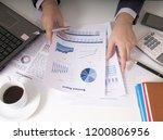 bisinessman working his job at... | Shutterstock . vector #1200806956