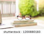red eyes glasses on books with... | Shutterstock . vector #1200880183
