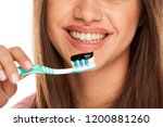young woman holding tooth brush ... | Shutterstock . vector #1200881260