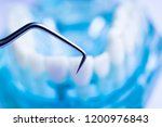 dentist cleaning teeth with...   Shutterstock . vector #1200976843