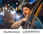 smiling man looking outside... | Shutterstock . vector #1200999970