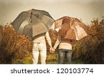 Young Couple Under An Umbrella...