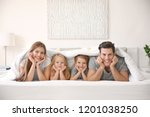 happy family lying under... | Shutterstock . vector #1201038250