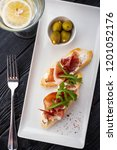 bruschetta with parma and goat... | Shutterstock . vector #1201052176
