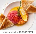 tartar of salmon and tuna with... | Shutterstock . vector #1201052179