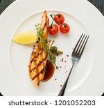 grilled salmon steak with lemon ... | Shutterstock . vector #1201052203