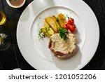 pork with white mushroom sauce... | Shutterstock . vector #1201052206